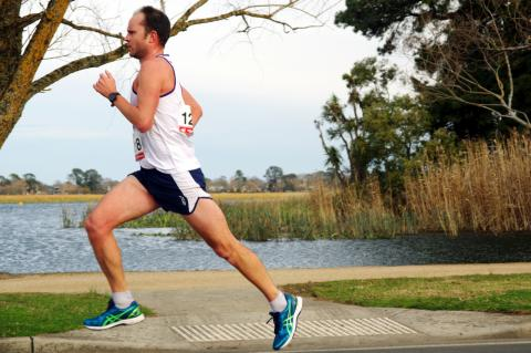 Damien Bertram strides out at the 15km road race at Lake Wendouree.